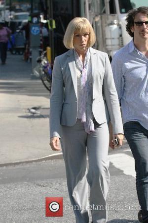 Frances McDormand walks back to her trailer after filming a scene for her new film 'Burn after Reading' New York...