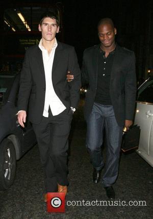 Marlon Harewood holding a very worse for wear Gareth Barry up, at Funky Buddha nightclub London, England - 19.12.07
