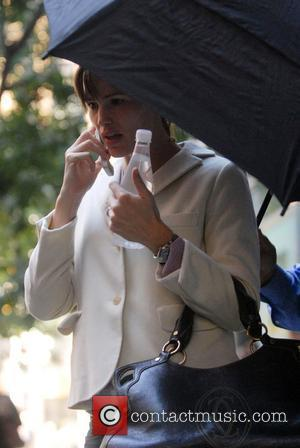 Jennifer Garner talking on her phone while trying to hide behind an umbrella New York City, USA - 21.10.07