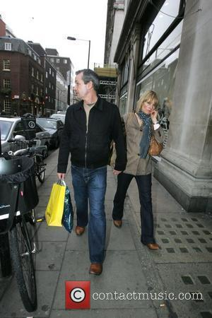 Football Manager George Burley Shopping Outside Selfridges With His Wife