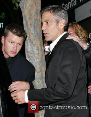 Clooney Praises 'Rock Star' Obama