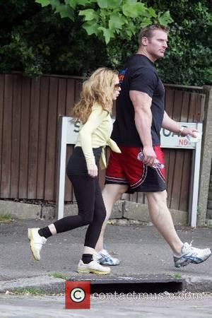 Geri Halliwell and her personal fitness trainer go to her local park to exercise London, England - 12.06.07