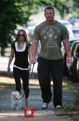 Geri Halliwell and her personal fitness instructor Tim Blakeley leave Geri's house to go for a jog with her dog...