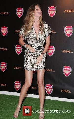 Gisele Bundchen Supermodel and Ambassador for Ebel, Gisele Bundchen poses for pictures with Thierry Henry of Arsenal Football Club. President...