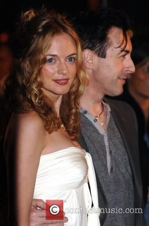 Heather Graham and Alan Cumming