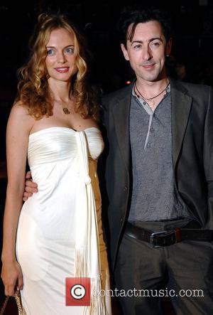 Heather Graham and Alan Cumming