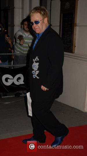 Elton John Defends Photo In Art Exhibit