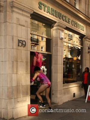 DJ Greg James visits a coffee house situated near the Radio 1 studios dressed in a showgirl's costume. The DJ...