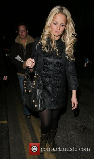 Jennifer Ellison stumbles down the street and gets into a waiting car after leaving Groucho club rather worse for wear,...