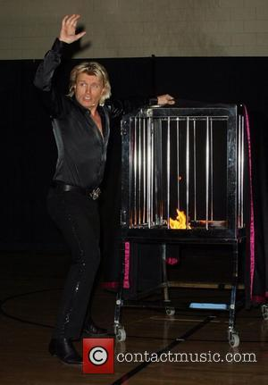 Hans Klok 'The World's Fastest Magician' performs his lightning quick illusions at the 'Andre Agassi Boys & Girls Club' Las...