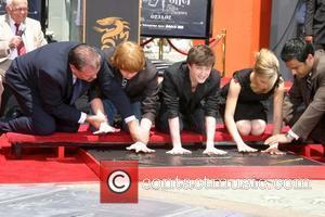 Rupert Grint, Daniel Radcliffe, and Emma Watson Harry Potter handprint, footprint, and wand ceremony held at the Grauman's Chinese Theatre...