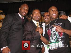 Floyd Mayweather (r) with Golden Boy Promoters and former World Champions Bernard Hopkins (l) Sugar Shane Mosley (cl) and Mayweather's...