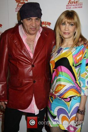 Steve Van Zandt and guest The Hawaiian Tropic Zone Grand Opening at Miracle Mile Shops in Planet Hollywood Resort And...