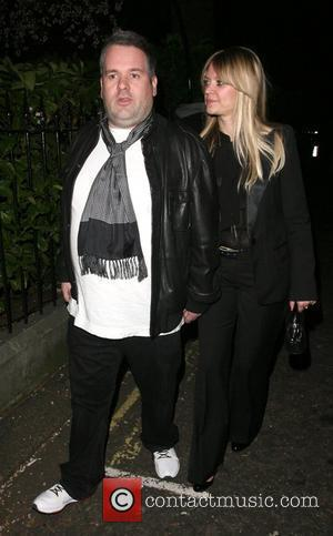 Chris Moyles and his girlfriend leaving the Universal records afterparty for the Brit Awards, held at the Hemple Hotel. London,...
