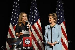 Democratic presidential hopeful U.S. Senator Hillary Clinton (D-NY) (2nd to left) stands with her (L-R) daughter Chelsea Clinton, Rep. Charles...