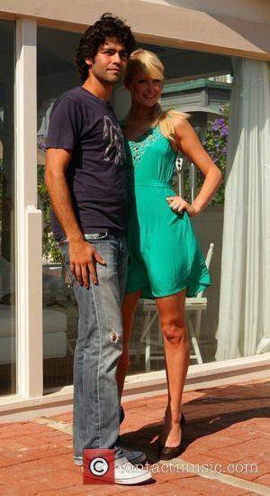 Adrian Grenier and Paris Hilton  posing for photographers at her Malibu beach house Los Angeles, California - 19.08.07