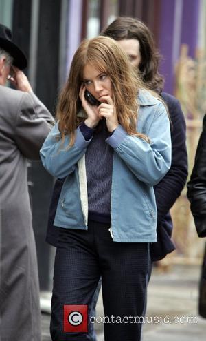 Sienna Miller  on location filming the 60's inspired movie 'Hippie Hippie Shake'. Sienna is wearing a limp brown wig...