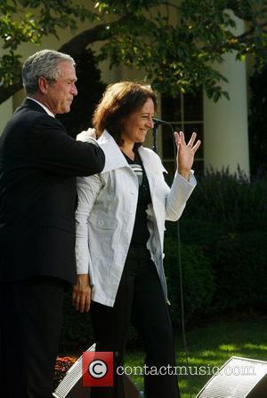 George Bush and Yamile Llanes Labrada