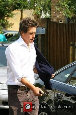 Hugh Grant leaving Jemima Khan's house shortly after police were seen arriving, then leaving London, England - 19.06.07