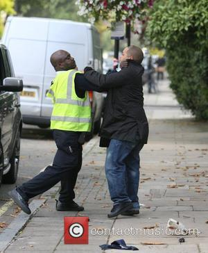 A driver is handed a parking ticket by a traffic warden in St Johns Wood. The irate driver tore up...