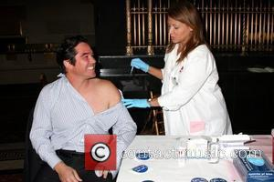 Dean Cain receives a flu shot Jennifer Garner and Dean Cain kick off the American Lung Association's 'Faces of Influenza'...