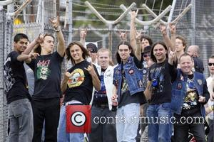Fans greeting Iron Maiden Iron Maiden, currently on their 'Somewhere Back In Time' tour, arrive into Sydney Airport aboard Ed...