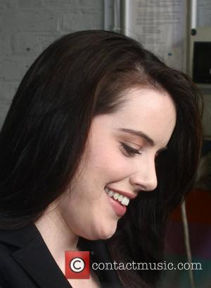 Michelle Ryan stops to sign an autograph as she leaves TV studios in central London. London, England - 11.03.08