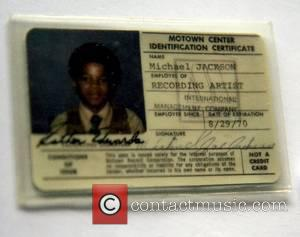 Michael Jackson's Motown identification card identifying him as a recording artist of International Management Company. Card expired in 1970 and...