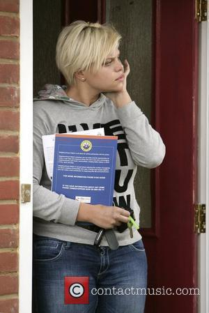 Jade Goody gets out of her car which has an out of date tax disc Down on her luck reality...