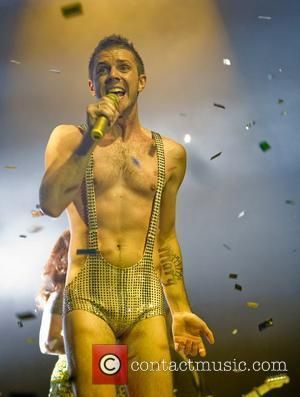 Jake Shears wearing a gold sequined leotard when performing the song ' I Don't Feel like Dancin ' in the...