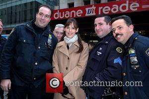 Jennifer Garner poses with New York City Police Officers as she departs Rockefeller Plaza after making an appearance on NBC's...