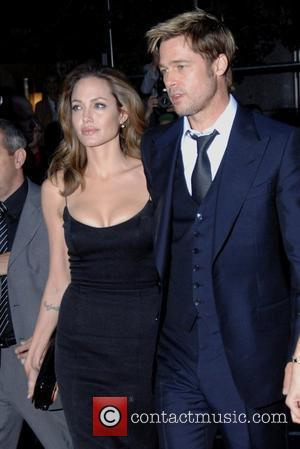 Jolie Shows Off Baby Bump
