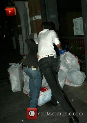 Jack Tweedy leaving Jewel, Covent Garden. He throw his friend over some bin bags in the street London, England -...
