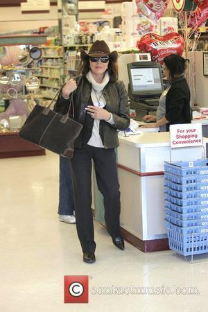Joan Collins goes shopping at Rite Aid and is then collected by Nicky Haskel Los Angeles, California - 16.02.08