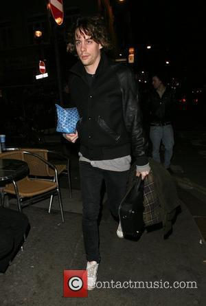 Johnny Borrell looks embarrassed as he leaves Balans restaurant in Soho having had a meal with a mystery female. They...