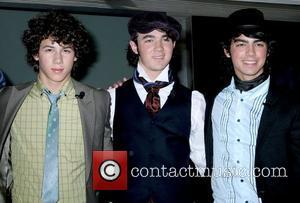 Nick Jonas, Kevin Jonas and Joe Jonas Jonas Brothers Demo-ing Music Industry's First CDVU+ Release  New York City, USA...