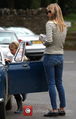 Kate Moss and Her Daughter Lila With A Male Friend Leaving Her Home To Go To A Pub In Little Faringdon