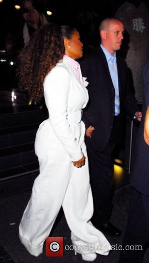 Janet Jackson leaving Katsuya nearly falls down the stairs when she gets her foot caught in her wide-leg trousers. Luckily...