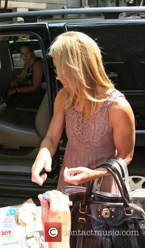 Kelly Ripa signs autographs while leaving ABC's Live with Regis and Kelly New York City, USA - 07.08.07