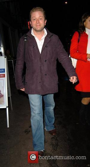 Jon Culshaw leaving the photocall for the launch of 'If You Can't Stand The Heat' at the Soho Theatre London,...