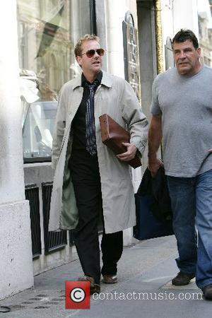 Kiefer Sutherland and a friend out shopping on Bond Street London, England - 28.06.07