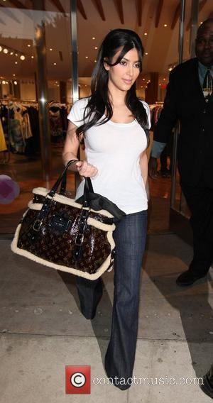 Kim Kardashian and Her Mother Kendall Shopping At Intermix Store At Robertson Blvd