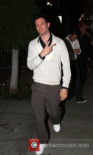 J.c. Chasez Throws A Peace Sign and Jordan