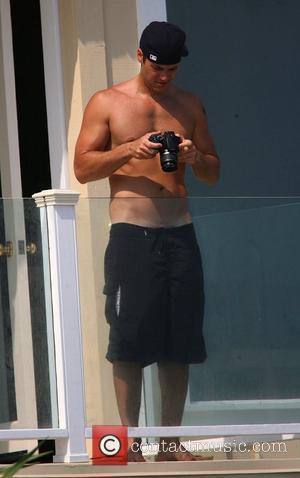 Nick Zano sunbathing on Malibu Beach Los Angeles, California - 31.07.07