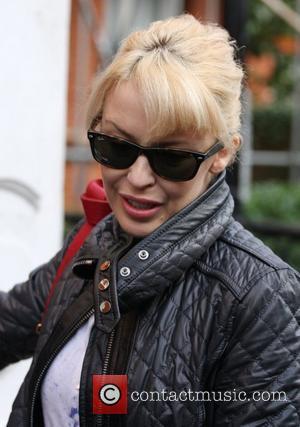 Minogue's Cheeky Nickname For Travolta