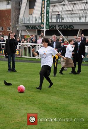 Sheree Murphy taking part in the Jockeys penalty shoot out in aid of Alderhey's Imagine Appeal at Lady's Day at...