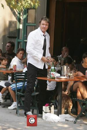 Simon Le Bon of the pop group Duran Duran having lunch outside a restaurant with bandmate Nick Rhodes New York...
