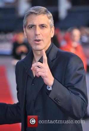 Clooney + Cheadle Honoured By Nobel Winners