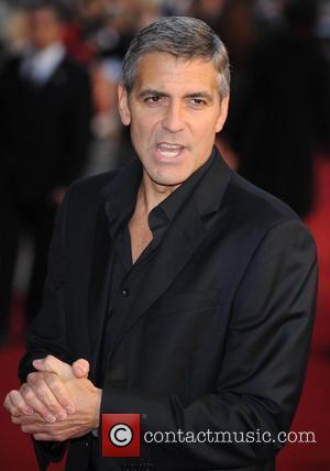 Clooney + Cheadle Rewarded For Darfur Work