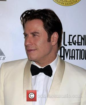Travolta Thrilled To Complete Cross-dressing Role